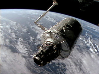 Italian Space Agency - Harmony, itself built in Italy on contract, was accompanied by Nespoli who acted as mission specialist. It is shown here being moved to its final docking port later the same year