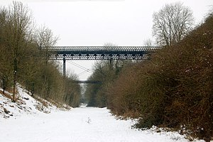 Leamington–Rugby line - Spanning the cutting at Marton Junction, this pioneering wrought-iron bridge is of trussed lattice girder construction.
