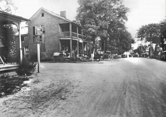 Lisbon, Maryland - The National Road passed through the middle of the village of Lisbon, with the 1804 Caleb Pancoast House in background- picture circa August 1912.