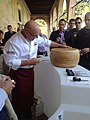 How to Cut a Wheel of Trentino Cheese (10078899254).jpg