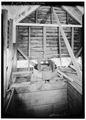 INTERIOR, SHOWING MILL-WHEEL WITHIN HOUSING - Alfred Raegan Tub Mill, Roaring Fork Trail, Gatlinburg, Sevier County, TN HABS TENN,78-GAT.V,4-5.tif