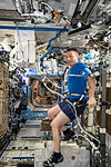 ISS-42 Terry Virts exercises on the Cycle Ergometer in the Destiny lab.jpg