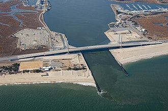 Indian River (Delaware) - Indian River Inlet, spanned by the Indian River Inlet Bridge that opened in 2012, photographed from over the Atlantic Ocean an altitude of 2,000 feet (610 meters) looking west toward Indian River Bay.