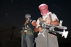 Iraqi insurgents with guns, 2006.jpg