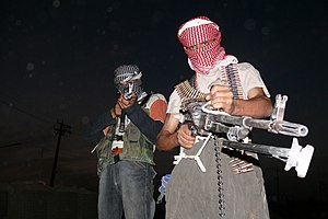 Iraqi insurgents with guns, 2006