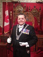 J. Greg Peters, Usher of the Black Rod, in the Senate Chamber.jpg
