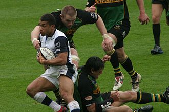 Jason Robinson (rugby player) - Robinson playing for Sale Sharks towards the end of the 2005–2006 Guinness Premiership in which he led the club to their first Premiership title.