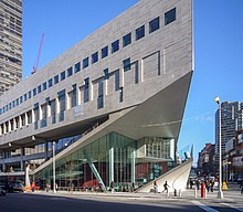 A picture of the Alice Tully Hall building at the Juilliard School in New York City, taken from across the street