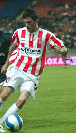 Killian Brennan - Brennan in action against PSG at Parc des Princes