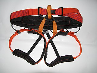 Climbing harness item of climbing equipment that secures a person to a rope or an anchor point