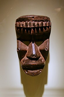 A wood carved, Krahn face mask on display at the National Museum of African Art