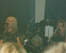 L7 onstage, Donita Sparks (left), Demetra Plakas (center), and Gail Greenwood (right)