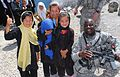 Lake City, S.C., Command Sergeant Major Chats with Afghan Children DVIDS300287.jpg