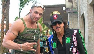 Jimmy Hart - Hart posing with Lance Hoyt