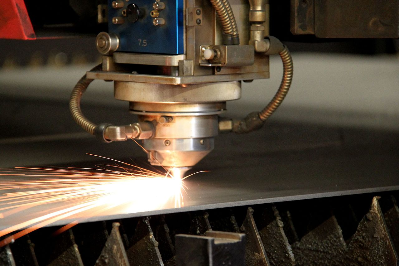 Laser cutter throws sparks as it runs through its programmed route