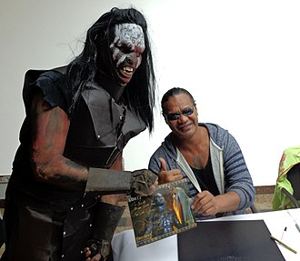 Lawrence Makoare - Makoare with a fan cosplaying as Lurtz, his character from The Lord of the Rings: The Fellowship of the Ring.
