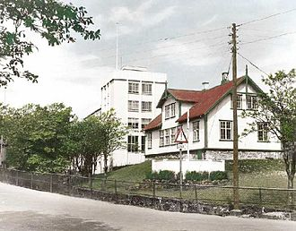 Løgting - Løgting house in the 1950s. The building in the background was from the Faroese telecom and belongs now to the Løgting as administration offices.