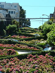 Cars negotiate Lombard Street to descend Russian Hill