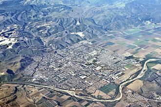 Lompoc, California - Lompoc from the air in 2007, looking SW. A large diatomaceous earth quarry in the Monterey Formation is just outside (south) of Lompoc. The nearly-dry Santa Ynez River flows west to the Pacific,  at bottom of frame.