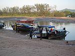 Longtail boats at Nopparat Thara harbour (12360046604).jpg