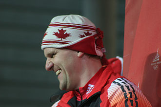 Three stripes - Pierre Lueders of Canada wearing an Adidas jacket with the modified stripe design at the 2006 Winter Olympics.