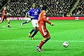 Luis Suarez runs at Distin 1.jpg