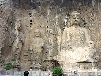 Wu Zetian - The Fengxian cave (c. 675 AD) of the Longmen Grottoes, commissioned by Wu Zetian; the large, central Buddha is representative of the Vairocana