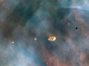 "Formation and evolution of the Solar System - Hubble image of protoplanetary discs in the Orion Nebula, a light-years-wide ""stellar nursery"" probably very similar to the primordial nebula from which the Sun formed"