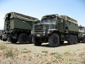 Medium Tactical Vehicle Replacement - MTVR MK23 standard cargo trucks with Armor Protection Kits (APKs) and armored rear troop carrier compartments