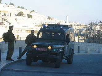 "AIL Storm - Members of the Israel Border Police with a ""Sufa"" Mini SUV in the Jewish Quarter of Jerusalem's Old City."