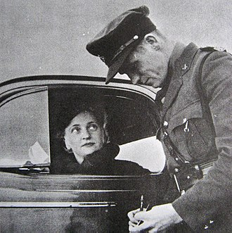 British Columbia Provincial Police - BCPP highway patrol officer issuing a ticket.