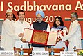 "Manmohan Singh presenting the ""Rajiv Gandhi National Sadbhavana Award"" to Dr. Kiran Seth of SPIC MACAY, at a function, in New Delhi. The President of ICCR, Dr. Karan Singh and the Member of Parliament.jpg"