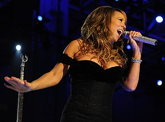 Critics have compared Grande's vocals to those of Mariah Carey (pictured). Mariah Carey Neighborhood Ball in downtown Washington 2009 cropped.JPG