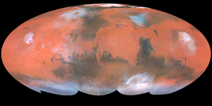 Martian surface - Mollweide projection of albedo features on Mars from Hubble Space Telescope. Bright ochre areas in left, center, and right are Tharsis, Arabia, and Elysium, respectively. The dark region at top center left is Acidalium Planitia. Syrtis Major is the dark area projecting upward in the center right. Note orographic clouds over Olympus and Elysium Montes (left and right, respectively). Photo Credit: Steve Lee (University of Colorado), Jim Bell (Cornell University), Mike Wolff (Space Science Institute), and NASA