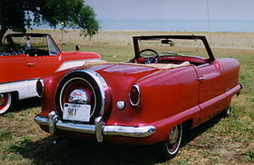 Metropolitan convertible red by lake.JPG