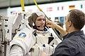 Michael Good dons training version of EMU spacesuit.jpg