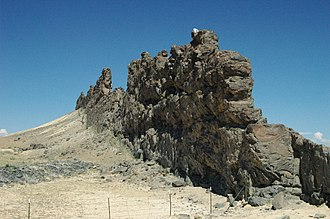 Dike (geology) - A dike of lamprophyre near the Shiprock volcanic plug, New Mexico, that has resisted the erosion that removed some of the softer rock into which the dike was originally intruded