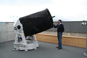 """José De Queiroz - José De Queiroz in his Restaurant """"Encarna"""" (left) and next to his 0.9-meter Cassegrain telescope"""