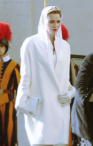 Privilège du blanc - The Princess Charlene of Monaco meeting Pope Francis on an official state visit at the Vatican.
