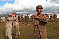 Mongolian Armed Forces 2nd Lt. B. Munkhbileg, right, with the Joint Training Center, translates as U.S. Marine Corps Gunnery Sgt. Mark Massalski, a nonlethal weapons instructor, and Lance Cpl. Samuel Ostic, an 130820-M-MG222-002.jpg