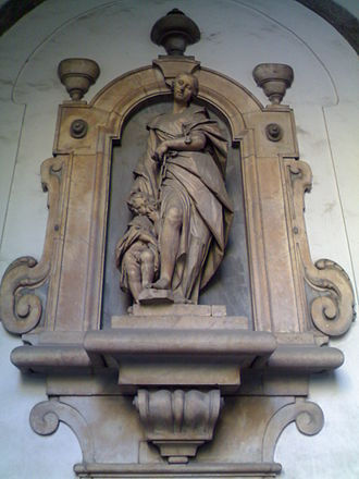Pio Monte della Misericordia - A sculpture at the entrance of the church