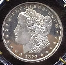 A coin depicting the profile of a young woman