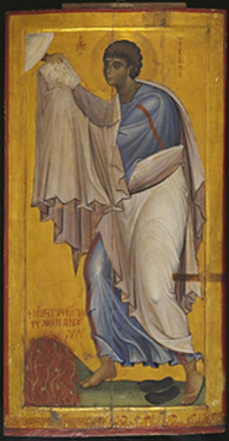 Burning bush - Icon of Moses receiving the Ten Commandments. The bush is depicted at his feet, lower left (Saint Catherine's Monastery, c. 1050).