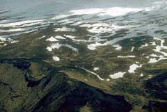 Aerial view of the Point Kadin vents, a series of post- glacial explosion pits and small cinder cones that occur along a fracture zone northwest of the summit of Makushin Volcano.