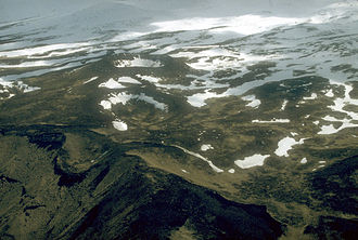 Unalaska, Alaska - Aerial view of the Point Kadin vents, a series of post-glacial explosion pits and small cinder cones that occur along a fracture zone northwest of the summit of Makushin Volcano.