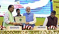 Narendra Modi being presented a memento by the Union Minister for Agriculture and Farmers Welfare, Shri Radha Mohan Singh, at the launching ceremony of the e-NAM - the e-trading platform for the National Agriculture Market.jpg