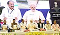 Narendra Modi releasing the Mission statement & Guidelines of the Smart Cities Mission, Atal Mission for Rejuvenation and Urban Transformation (AMRUT) and Housing for All Mission.jpg