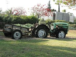A tractor near Netiv HaAsara's concrete shelter.