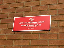 Photo of Manchester United Football Club red plaque