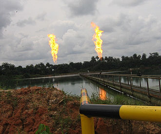 Gas flare - Flaring of associated gas from an oil well site in Nigeria.